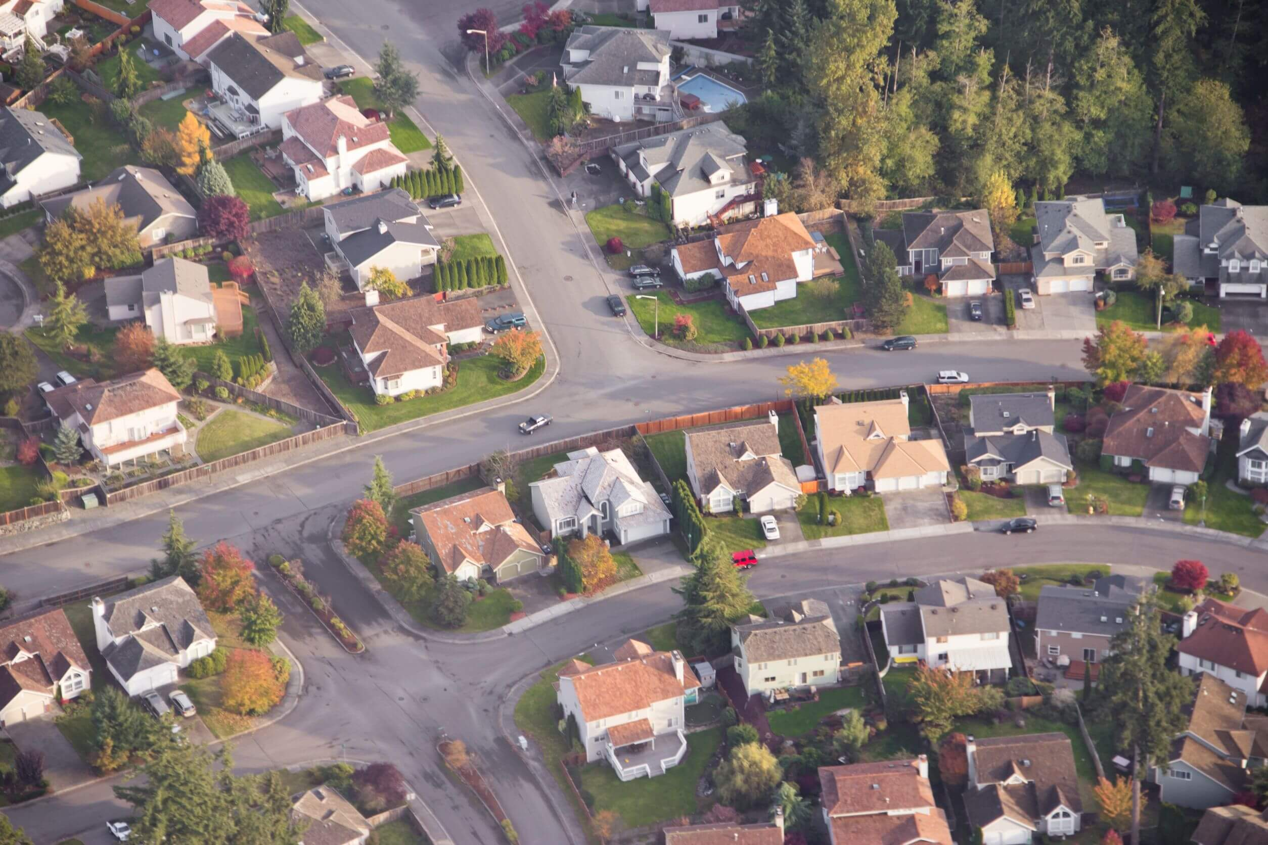 11268329 aerial view of single car driving on a for Best neighborhoods in los angeles for singles